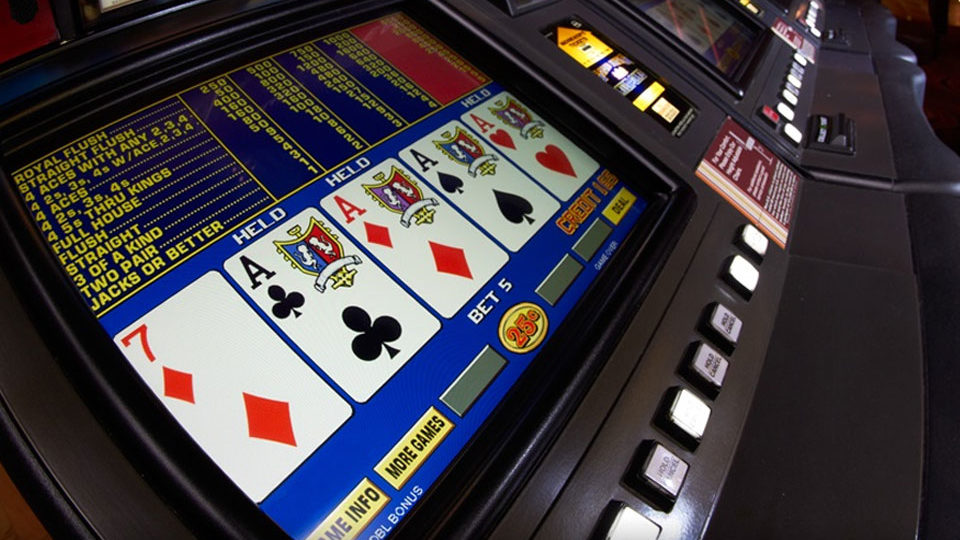 Seven and four aces displayed on video poker machine