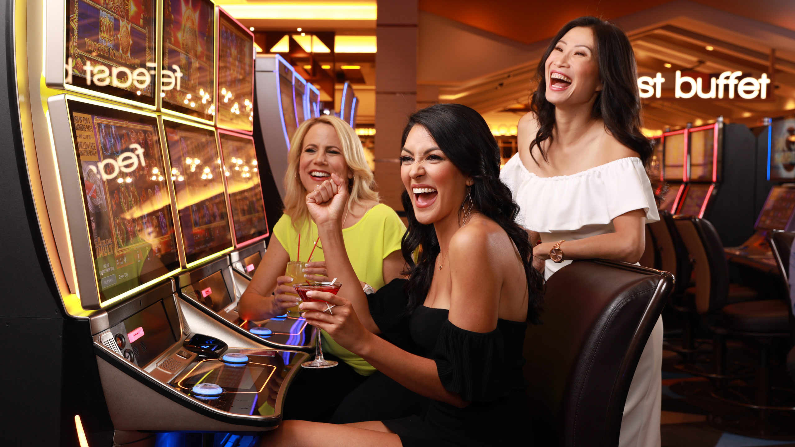 Three Women Cheering at a slot machine