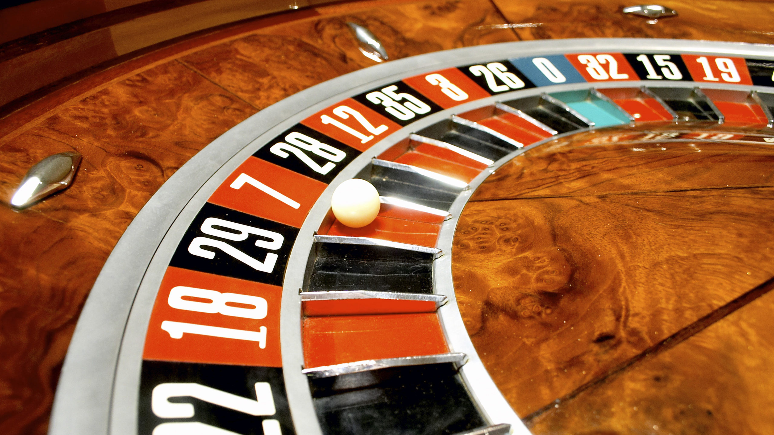 Close up of  Roulette Wheel with white ball in number seven
