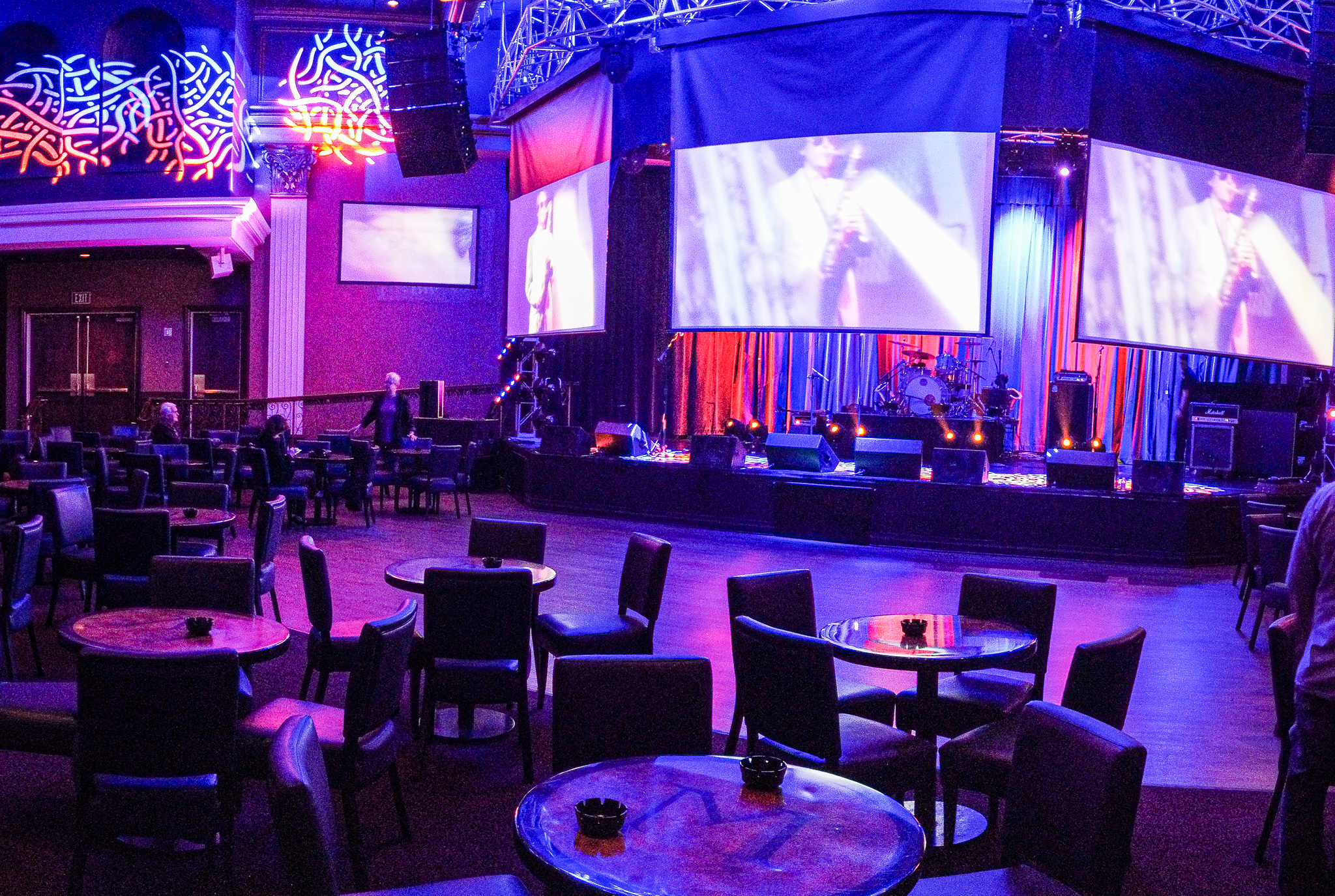 a photo of club madrid wit blue and purple lighting