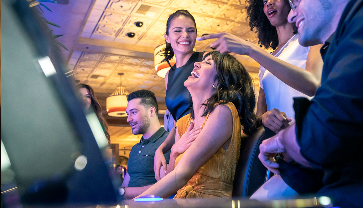 a photo of a girl and group of friends playing slots