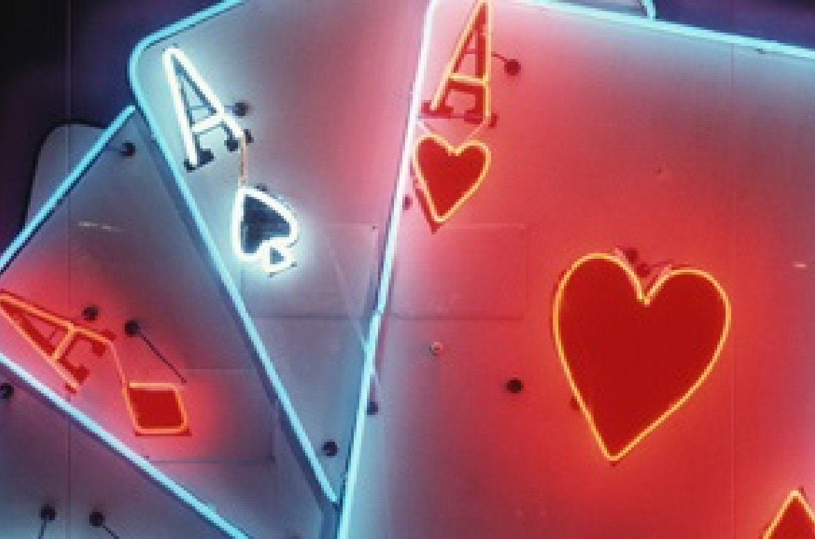 a photo of 3 neon aces
